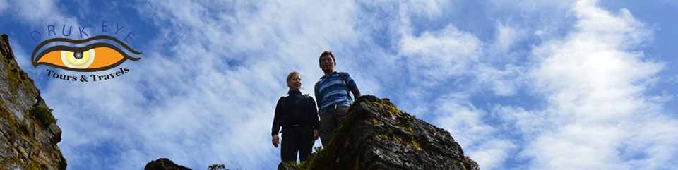 Two hikers on a steep rock